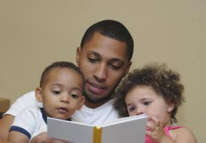 father-reading-with-children