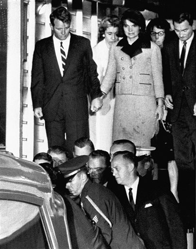 FILE - In this Friday, Nov. 22, 1963 file photo, Jacqueline Kennedy, with bloodstains on her clothes, holds hands with her brother-in-law, Attorney General Robert Kennedy, as the coffin carrying the body of President John F. Kennedy is placed in an ambulance after arriving at Andrews Air Force Base, Md. near Washington. President Kennedy was assassinated earlier that afternoon in Dallas.    Read more here: http://www.sacbee.com/2013/11/02/5839776/images-from-jfk-assassination.html#storylink=cpy