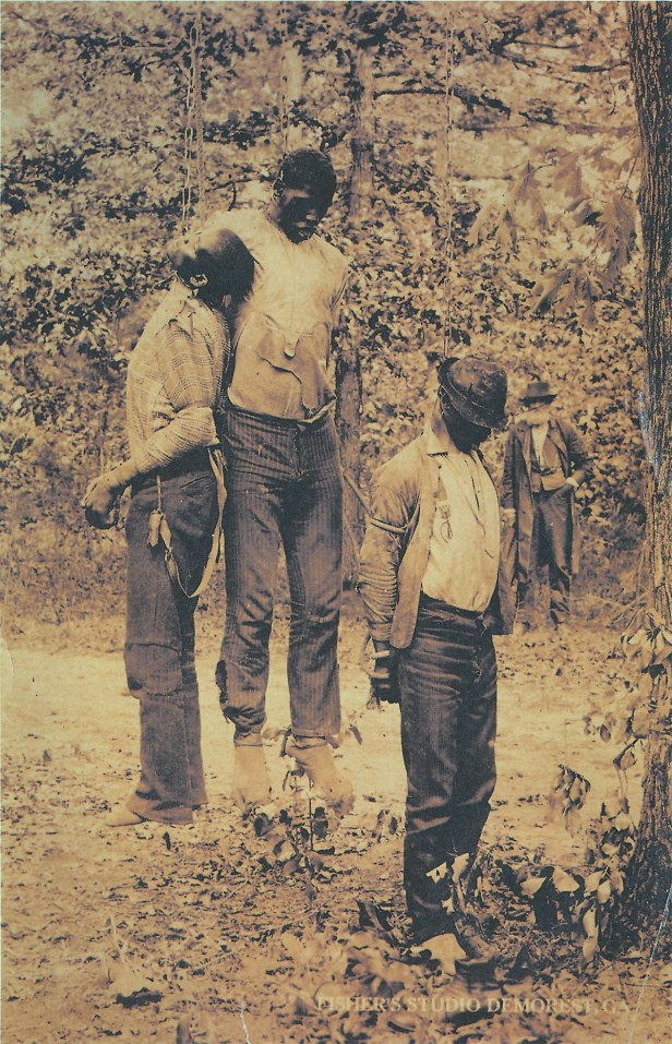 Whites hanged niggers or darkys as we were referred to then left us  hanging for white folks to enjoy