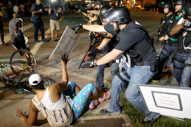 Ferguson  PD:  FUCK AMERICANS  Mercenaries Deployed To Trample Our Rights