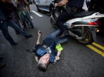 Ari-Douglas-pinned-by-NYPD-scooter-300x223