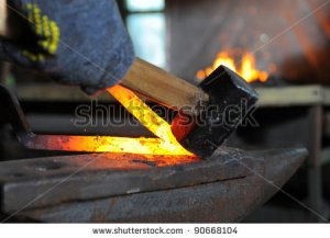 stock-photo-blacksmith-forges-a-red-hot-iron-in-the-forge-90668104