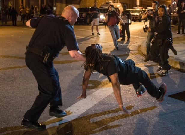 Unarmed protestor accosted by a cop