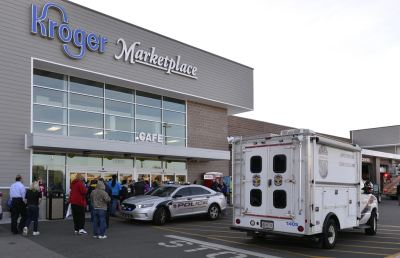 Employees wait outside the entrance of a Kroger grocery store following a shooting that left two people dead and a suspect in custody, Oct. 24, 2018, in Jeffersontown, Ky. Photo: Timothy D. Easley/AP